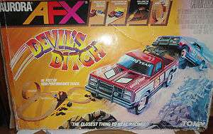 Aurora AFX Tomy Devils Ditch GMC Turbo Truck Race Set